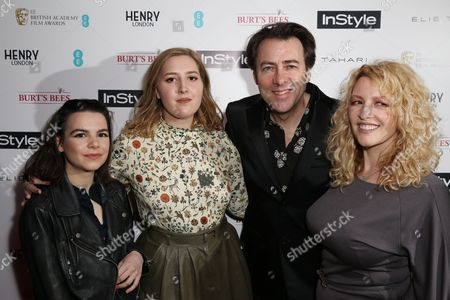 Guest, Honey Kinney Ross, EE Rising Star Jury member and television presenter Jonathan Ross and Jane Goldman