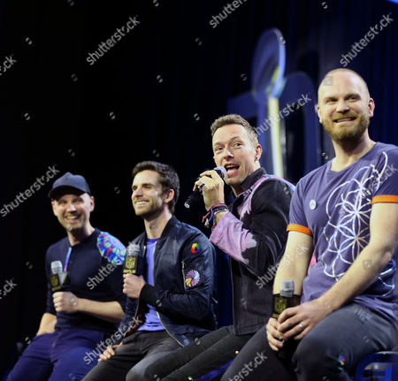 Stock Photo of Musicians Jonny Buckland, Guy Berryman, Chris Martin and Will Champion of Coldplay speak onstage at the Helen DeMacque Super Bowl Halftime Press Conference on February San Francisco, California.