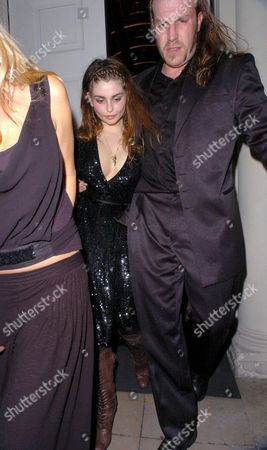 Aimee Osbourne is helped out of the party