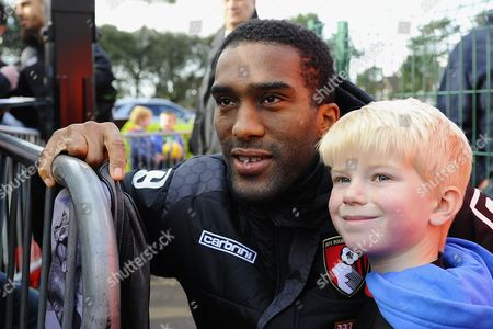 Sylvain Distin of AFC Bournemouth poses for a picture with a young fan during AFC Bournemouth vs Arsenal, Barclays Premier League Football at the Vitality Stadium
