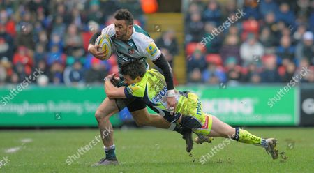 Leicester's Peter Betham tackled by Sale's Chris Cusiter (R) - Rugby Union - Aviva Premiership - 06/02/16 - Leicester Tigers v Sale Sharks - at Welford Road, Leicester UK.