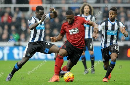 Victor Anichebe of West Bromwich Albion  and Cheik Tiote and Rolando Aarons of Newcastle United during the Barclays Premier League match between Newcastle United and West Bromwich Albion at St James Park on the 6th of February 2016