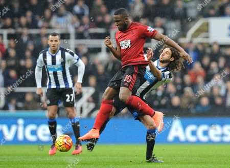 Fabricio Coloccini of Newcastle United and Victor Anichebe of West Bromwich Albion  during the Barclays Premier League match between Newcastle United and West Bromwich Albion at St James Park on the 6th of February 2016