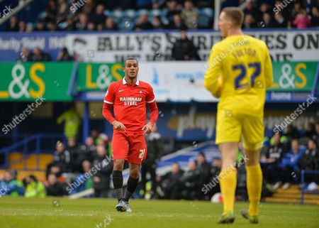 Leyton Orient Forward Jay Simpson and Portsmouth goalkeeper Ryan Fulton during the Sky Bet League 2 match between Portsmouth and Leyton Orient at Fratton Park, Portsmouth