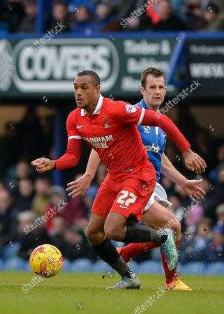 Leyton Orient Forward Jay Simpson breaks away from Portsmouth midfielder Michael Doyle during the Sky Bet League 2 match between Portsmouth and Leyton Orient at Fratton Park, Portsmouth