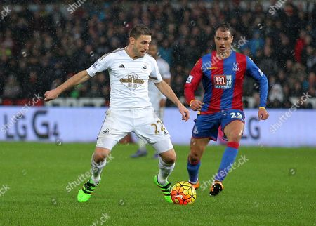 (L-R) Angel Rangel of Swansea against Marouane Chamakh of Crystal Palace during the Barclays Premier League match between Swansea City and Crystal Palace at the Liberty Stadium, Swansea on February 06 2016