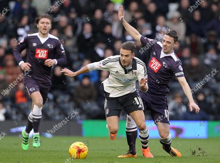 Alex Kacaniklic of Fulham and Chris Baird of Derby County challenge for the ball
