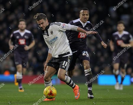 Alex Kacaniklic of Fulham and Marcus Olsson of Derby County challenge for the ball