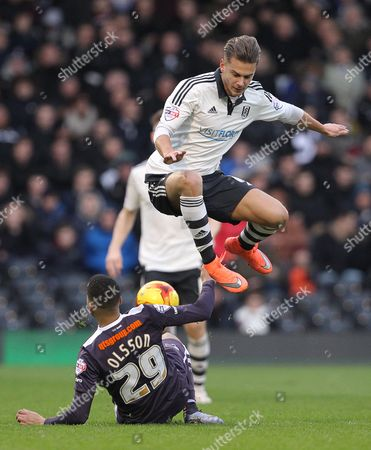 Alex Kacaniklic of Fulham is challenged by Marcus Olsson of Derby County