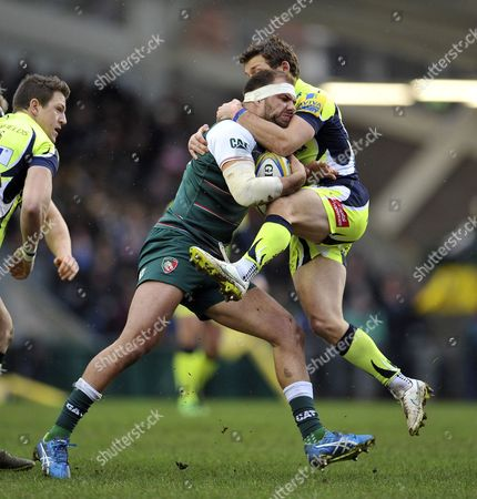 Stock Photo of Lachlan McCaffrey of Leicester Tigers is tackled by Chris Cusiter of Sale Sharks