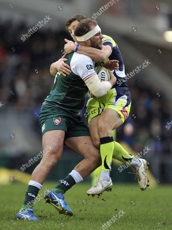 Stock Image of Lachlan McCaffrey of Leicester Tigers is tackled by Chris Cusiter of Sale Sharks