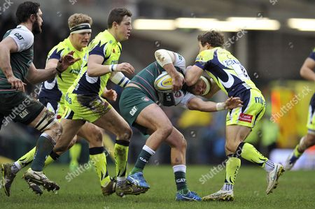 Lachlan McCaffrey of Leicester Tigers is tackled by Chris Cusiter of Sale Sharks