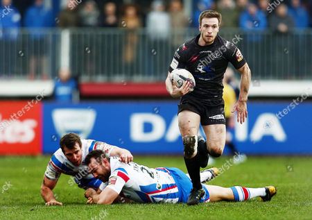 Joe Mellor of Widnes Vikings breaks away from Scott Anderson Matty Ashurst of Wakefield Wildcats and during the First Utility Super League match between Wakefield Wildcats and Widnes Vikings played at The Rapid Solicitors Stadium Belle Vue, Wakefield on February 7th 2016