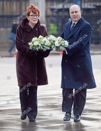 Editorial photo of Randolph Churchill (right And Celia Sandys Lay A Wreath At The Churchill Statue In Parliament Square.