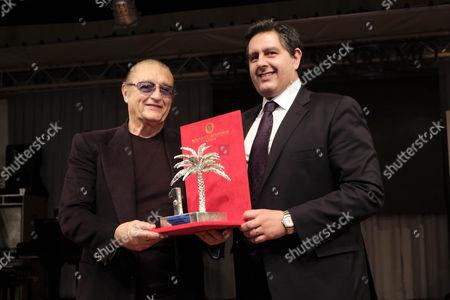 Tony Renis receives the NumeriUno from Giovanni Toti, Presidente della Regione Liguria