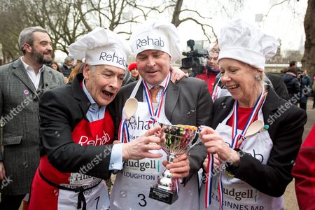 Alastair Stewart, Tim Loughton MP and Liz McInnes MP hold the Parliamentary Pancake Race trophy