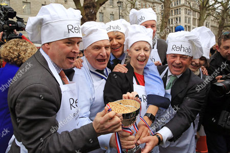 Stock Image of Tim Loughton MP, Stephen Pound MP, Clive Lewis MP, Liz McInnes MP, David Burrowes MP and Alan Duncan MP - winning team with the trophy