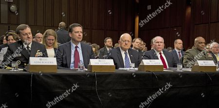 From left to right: Director Admiral Michael Rogers, Director of the National Security Agency (NSA); Director James Comey, Director of the Federal Bureau of Investigation (FBI); Director James Clapper, Director of National Intelligence (DNI); Director John O. Brennan, Director of the Central Intelligence Agency (CIA); and Director Lieutenant General Vincent Stewart, Director of the Defense Intelligence Agency (DIA) testify