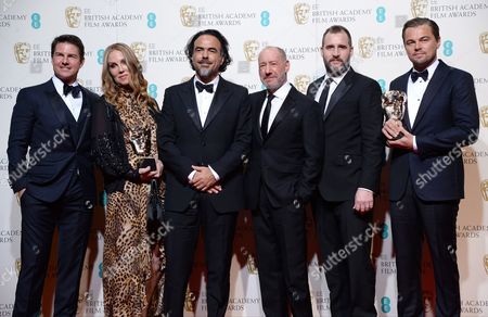 Tom Cruise poses with Best Film winners Mary Parent, Alejandro Gonzalez Inarritu, Steve Golin, Keith Redmon and Best Actor winner Leonardo DiCaprio for 'The Revenant'