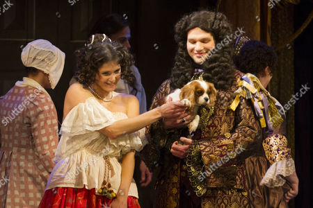 Gemma Arterton (Nell Gwynn) and David Sturzaker (Charles II), with Milly, during the curtain call