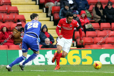 Reza Ghoochannejhad of Charlton takes the ball past Cardiff's Scott Malone during Charlton Athletic vs Cardiff City, Sky Bet Championship Football at The Valley