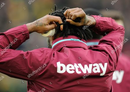 Alex Song of West Ham United ties his hair back during the Barclays Premier League match between Norwich City and West Ham United played at Carrow Road, Norwich on February 13th, 2016