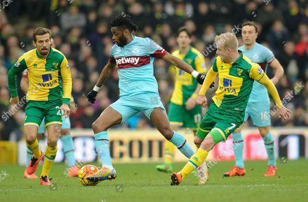 Stock Picture of Alex Song of West Ham United is flanked by Gary O'Neil and Steven Naismith of Norwich City during the Barclays Premier League match between Norwich City and West Ham United played at Carrow Road, Norwich on February 13th, 2016