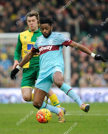 Jonny Howson of Norwich City and Alex Song of West Ham United during the Barclays Premier League match between Norwich City and West Ham United played at Carrow Road, Norwich on February 13th, 2016
