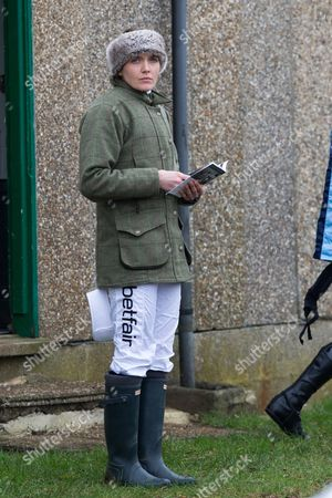Stock Photo of Victoria Pendleton studying the form guide