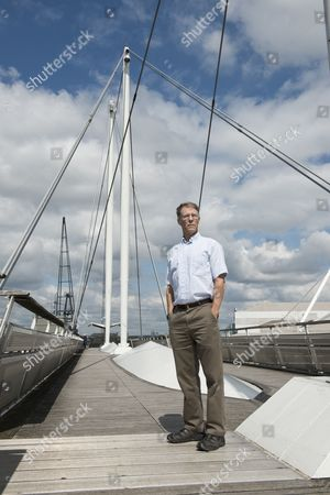London United Kingdom - August 15: Portrait Of American Science Fiction Author Kim Stanley Robinson Photographed At Royal Victoria Dock Bridge In London On August 15 2014. Robinson Is Best Known For His Mars Trilogy Series Of Novels