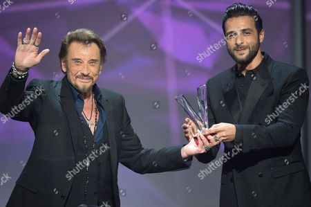 Stock Photo of Johnny Hallyday receives the award for best album from Maxim Nucci