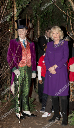 Camilla with actor Jonathan Slinger as Willy Wonka touring the exhibition. Camilla Duchess of Cornwall attending a preview of the new Wondercrump World of Roald Dahl Exhibition at the Southbank Centre which celebrates the authors Centenary.