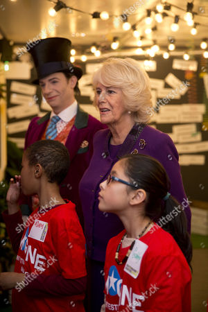Stock Image of Camilla Duchess of Cornwall attending a preview of the new Wondercrump World of Roald Dahl Exhibition at the Southbank Centre which celebrates the authors Centenary. Jonathan Slinger as Willy Wonka