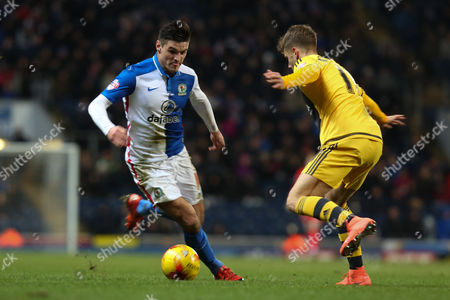Ben Marshall of Blackburn Rovers runs at Alex Kacaniklic of Fulham during the Sky Bet Championship match between Blackburn Rovers and Fulham at Ewood Park, Blackburn