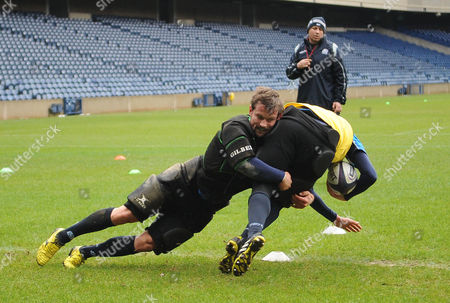 Peter Horne - Scotland centre puts in a crunching tackle on team mate Finn Russell as assistant coach Matt Taylor looks on. Scotland rugby union training session, Murrayfield Stadium, Edinburgh, Scotland, 17 February 2016. ***Please credit: David Gibson/Fotosport***