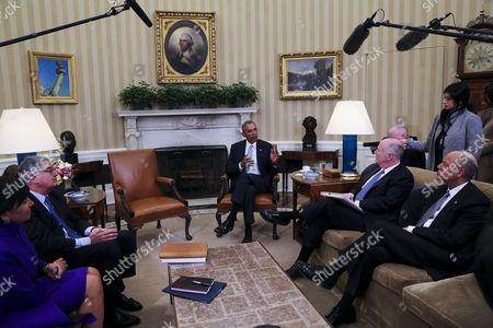 President Barack Obama, former National Security Advisor Tom Donilon and former IBM CEO Sam Palmisano with Commerce Secretary Penny Pritzker and Secretary of Homeland Security Jeh Johnson