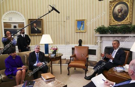 President Barack Obama, former National Security Advisor Tom Donilon, former IBM CEO Sam Palmisano and Commerce Secretary Penny Pritzker