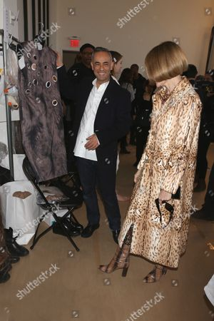 Francisco Costa and Anna Wintour, showing pieces from the collection backstage