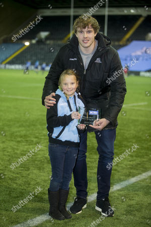 19/02/16 RUGBY PARK - KILMARNOCK - GUINNESS PRO12 Glasgow Warriors v Munster. Glasgow Warriors Jonny Gray collects his mccrea player of month award from emma hamilton