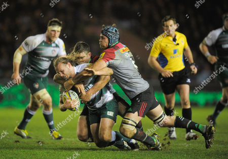 James Horwill and Nick Easter of Harlequins tackle Sam Harrison of Leicester Tigers during the Aviva Premiership Rugby match between Harlequins and Leicester Tigers played at the Twickenham Stoop, Twickenham on February 19th, 2016