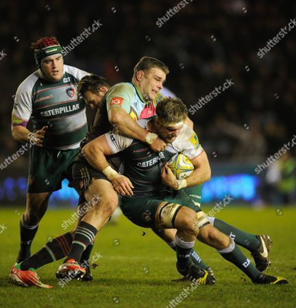 Michael Fitzgerald of Leicester Tigers is tackled by Nick Easter of Harlequins during the Aviva Premiership Rugby match between Harlequins and Leicester Tigers played at the Twickenham Stoop, Twickenham on February 19th, 2016