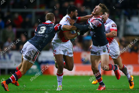 St Helens' Dominique Peroux is tackled by Sydney Roosters' Dale Copley and Jackson Hastings.