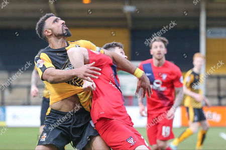 York City forward Reece Thompson  gets hold of Cambridge United defender Leon Legge  during the Sky Bet League 2 match between Cambridge United and York City at the R Costings Abbey Stadium, Cambridge