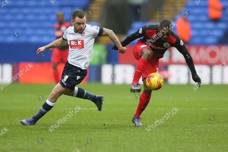 Queens Park Rangers David Hoilett  and Bolton Wanderers Jay Spearing during the Sky Bet Championship match between Bolton Wanderers and Queens Park Rangers played at the Macron Stadium, Bolton on February 20th 2015