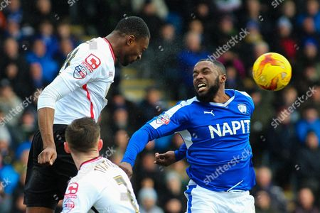 Crewe Alexandra defender Semi Ajayi and Chesterfield FC forward Sylvan Ebanks-Blake challenge for the ball in the air during the Sky Bet League 1 match between Chesterfield and Crewe Alexandra at the Proact stadium, Chesterfield