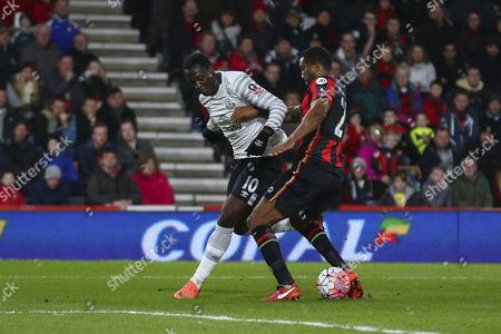 Sylvain Distin of Bournemouth tackles Romelu Lukaku of Everton