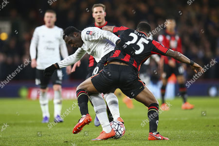 Sylvain Distin of Bournemouth holds Romelu Lukaku of Everton off the ball