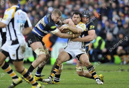 George Smith of Wasps is double-tackled by Dominic Day and Charlie Ewels