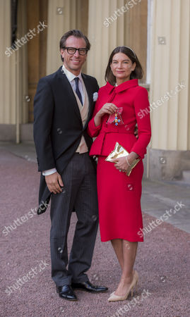 Natalie Massenet, fashion entrepreneur and former journalist, who founded the designer fashion portal Net-a-Porter seen have receiving her Dame Commander of the Most Excellent Order of the British Empire (DBE)  seen with her Swedish entrepreneur Erik Torstensson.