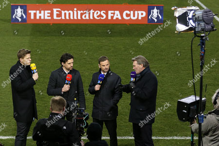 Stock Image of Jake Humphries, Owen Hargreaves and Richie Wellens listen to Glenn Hoddle talk on BT Sport pitchside ahead of the Emirates FA Cup 5th Round match played between Shrewsbury Town v Manchester United at Greenhous Meadow Stadium, Shrewsbury on February 22nd 2016